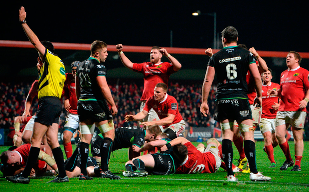 Munster players celebrate their team's fourth try scored by David Kilcoyne, far left. Photo by Cody Glenn/Sportsfile