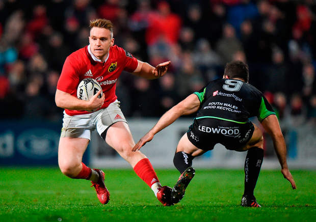 Munster's Rory Scannell in action against Ospreys' Tom Habberfield. Photo by Cody Glenn/Sportsfile