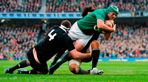 Rory Best breaks through the tackles of New Zealand's Brodie Retallick, left, and Steven Luatua during the 2013 Test. Photo: Sportsfile