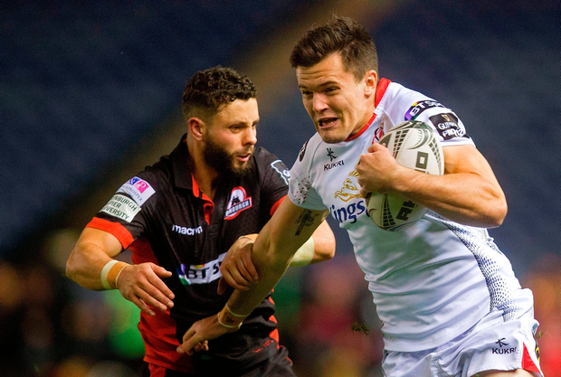Ulster's Jacob Stockdale fends off Edinburgh's Sean Kennedy. Photo by Graham Stuart/Sportsfile
