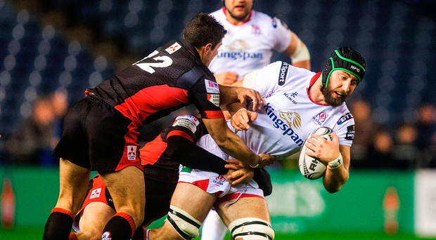 Ulster's Pete Browne is brough down by Phil Burleigh. Photo by Graham Stuart/Sportsfile