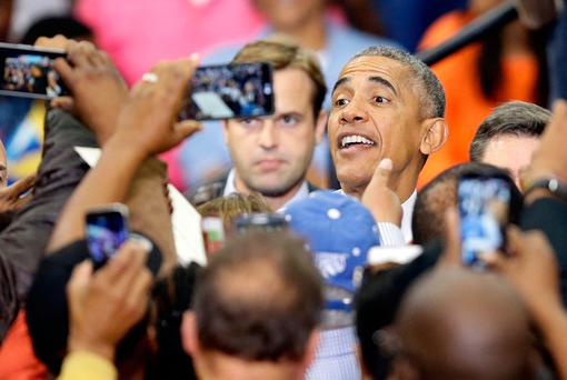 President Barack Obama greets supporters following his speech while campaigning for Democratic presidential candidate Hillary Clinton at Fayetteville State University in Fayetteville, North Carolina. Photo: AP
