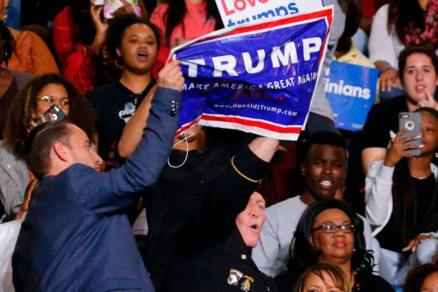 A Donald Trump supporter disrupts remarks by US President Barack Obama at a Hillary for America campaign event at the Fayetteville State University in Fayetteville, North Carolina. Photo: Reuters