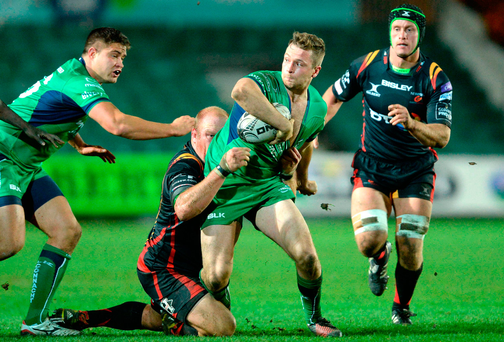 Connacht's Jack Carty is tackled by Dragons' Brok Harris. Photo by Gareth Everett/Sportsfile