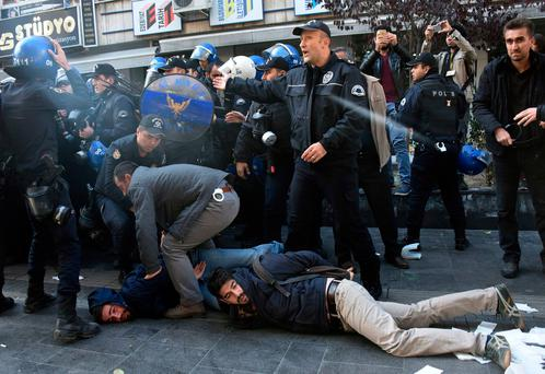 Police officers detain supporters of pro-Kurdish Peoples' Democratic Party, HDP, as they protest the detentions of Kurdish lawmakers, in Ankara, Turkey. Photo: AP