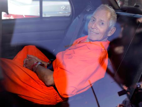 New York real estate heir Robert Durst smiles as he is transported from Orleans Parish Criminal District Court to the Orleans Parish Prison after his arraignment on murder charges in New Orleans (AP Photo/Gerald Herbert, File)