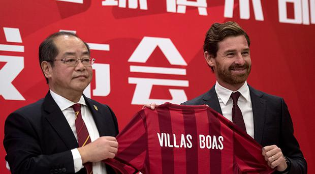 Andre Villas-Boas (R), the newly announced football coach for Shanghai SIPG FC, holds a jersey with his name beside general manager Sui Guoyang during a press conference in Shanghai on November 4, 2016. Chinese side Shanghai SIPG named the former Chelsea boss Villas-Boas as their new coach on November 4, replacing ex-England manager Sven-Goran Eriksson whose departure from the big-spending club was announced earlier. / AFP / Johannes EISELE (Photo credit should read JOHANNES EISELE/AFP/Getty Images)
