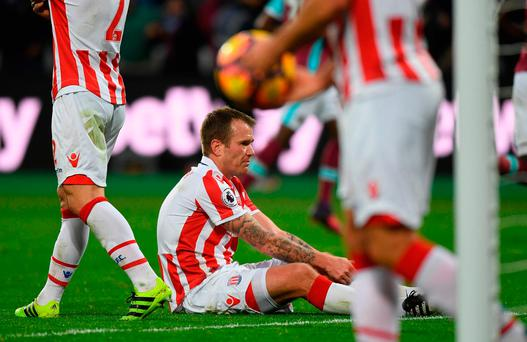 Glenn Whelan of Stoke City looks dejected after scoring a home goal