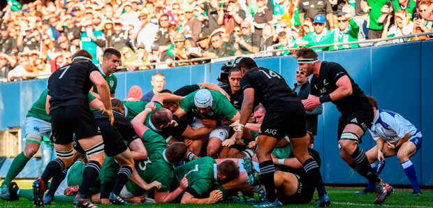 Jordi Murphy of Ireland scores his side's first try against New Zealand