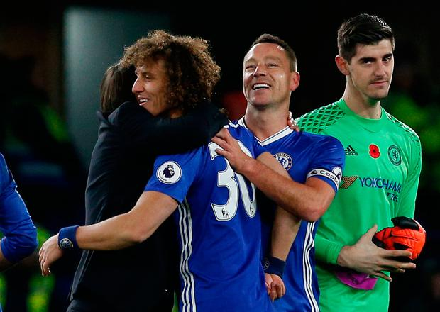 Chelsea manager Antonio Conte with Chelsea's John Terry and David Luiz after the match