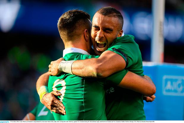 Conor Murray of Ireland is congratulated by team-mate Simon Zebo, right, after scoring their side's third try against New Zealand during the International rugby match between Ireland and New Zealand at Soldier Field in Chicago, USA. Photo by Brendan Moran/Sportsfile