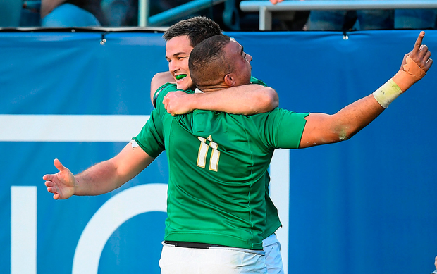 Simon Zebo, right, celebrates with team-mate Jonathan Sexton after scoring their side's fourth try against New Zealand