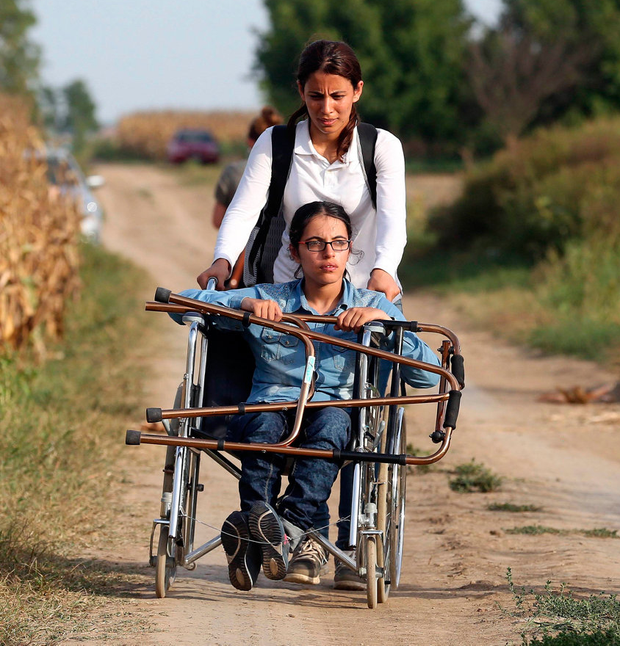 Optimism: Nujeen Mustafa on the road from Syria to Germany in August 2015 Photo: AFP PHOTO / STR