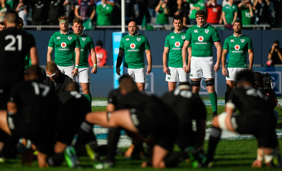Ireland players face the New Zealand haka while forming a figure of eight in honour of Anthony Foley Photo: Brendan Moran/Sportsfile
