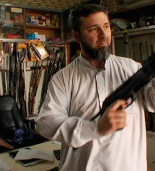 In a scene from the documentary 'Holy Wars' Kelly is seen visiting a gun shop in the Lebanon in 2010