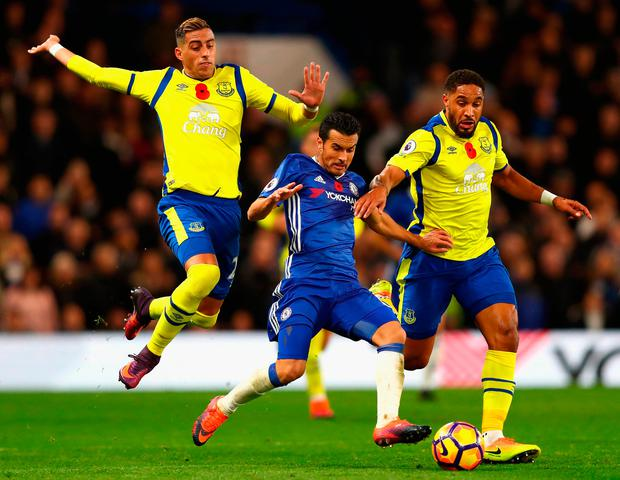 Everton's Ramiro Funes Mori and Ashley Williams challenge Chelsea's Pedro. Photo: Getty