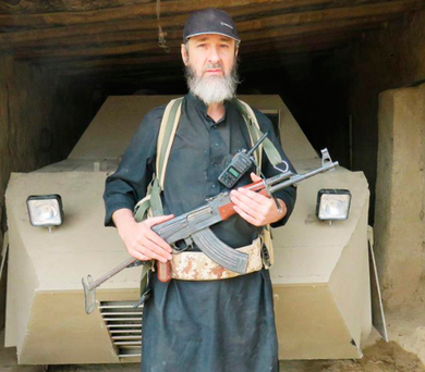 Converted to hate: Terence 'Khalid' Kelly poses in front of the vehicle in which he blew himself up