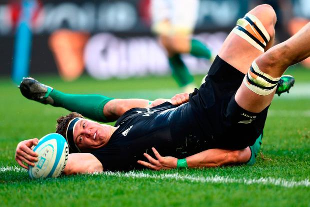 Debut cap Scott Barrett of New Zealand touches down to score his team's third try. Photo: Getty