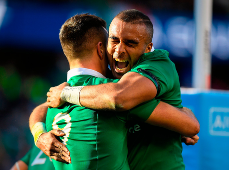 Ireland's Conor Murray and team-mate Simon Zebo can hardly contain their emotions on an historic night for Irish rugby. Photo: Brendan Moran