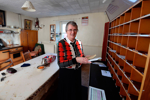 Last light: Nora O'Connor a third generation post mistress at Ballyduff post office in Co Kerry Photo: Domnick Walsh / Eye Focus LTD