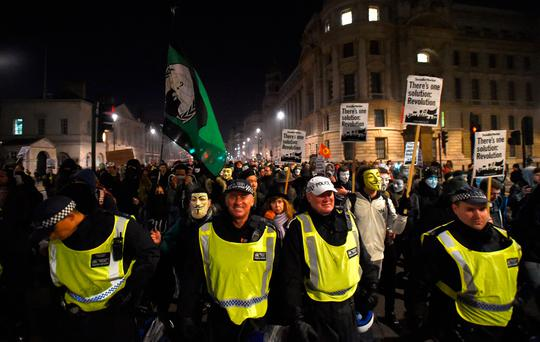 Protestors follow police down Whitehall, London, during the Million Mask March bonfire night protest organised by activist group Anonymous.Credit: David Mirzoeff/PA Wire
