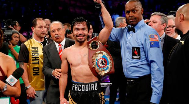 Manny Pacquiao celebrates his victory over WBO welterweight champion Jessie Vargas
