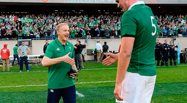 Ireland head coach Joe Schmidt, left, and Devin Toner celebrate victory