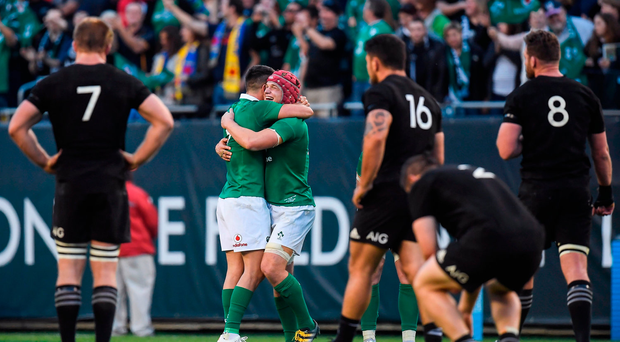 Josh van der Flier, right, and Conor Murray of Ireland celebrate victory after the International rugby match between Ireland and New Zealand at Soldier Field in Chicago