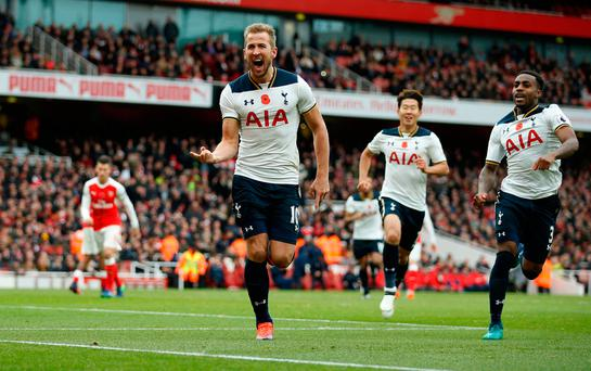 Tottenham's Harry Kane celebrates scoring their first goal from the penalty spot details.