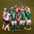 Referee Roberts Rogers separates players from both sides during the FAI Cup Final match between Cork City and Dundalk