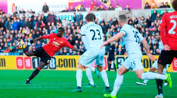 Paul Pogba of Manchester United scores his side's first goal