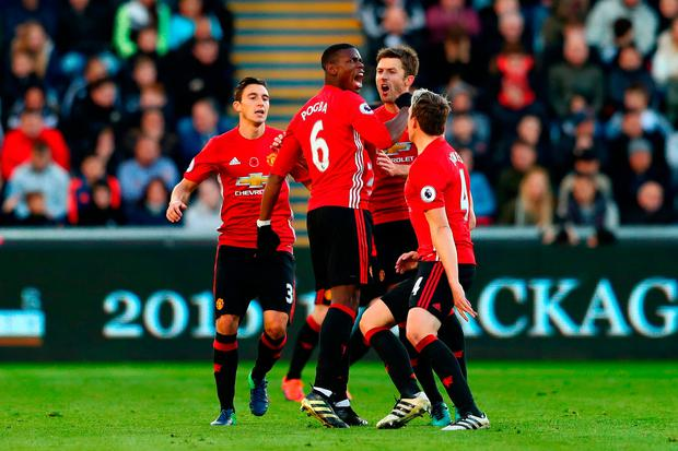 Paul Pogba of Manchester United celebrates with team mates