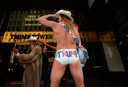 6 Nov 2016; The Naked Cowboy(s) entertaining crowds outside Trump Tower, 5th Avenune, New York, USA. Picture: Caroline Quinn