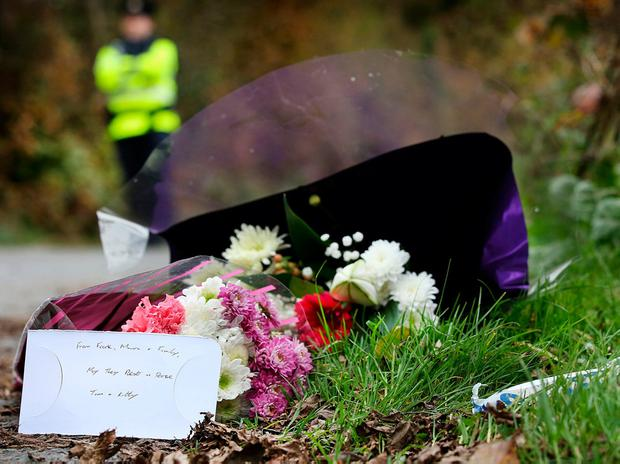 Flowers left by relatives at the sealed off road in Knockadoon outside Tom and Kitty Fitzgerald's home. Pic Steve Humphreys