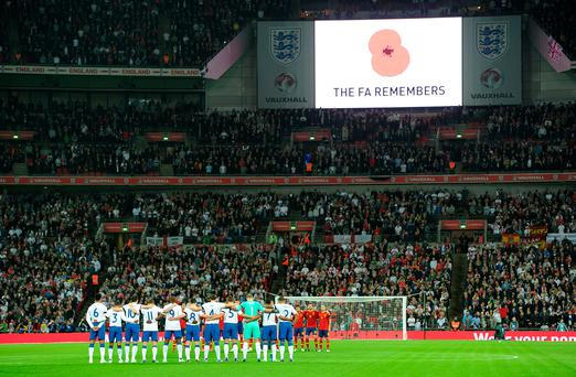 Both teams and the fans observe a minutes silence for Remembrance Day before the game between England and Scotland on November 11, 2011 at Wembley Photo: Anthony Devlin/PA