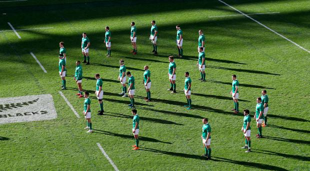 Ireland face the haka in a shape of eight in memory of Anthony Foley. Photo: INPHO/Billy Stickland