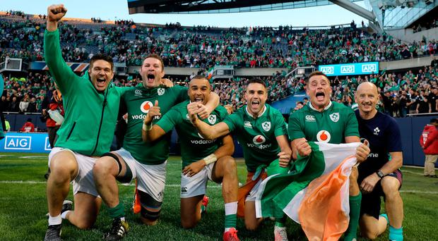 Munster and Ireland players Billy Holland, Donnacha Ryan, Simon Zebo, Conor Murray and CJ Stander celebrate winning with physio Dave Revins. Photo: INPHO/Dan Sheridan