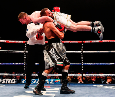 Paddy Barnes is lifted onto the shoulders of Stefan Slavchev, resulting in the stoppage of their flyweight bout. Photo: Ramsey Cardy/Sportsfile