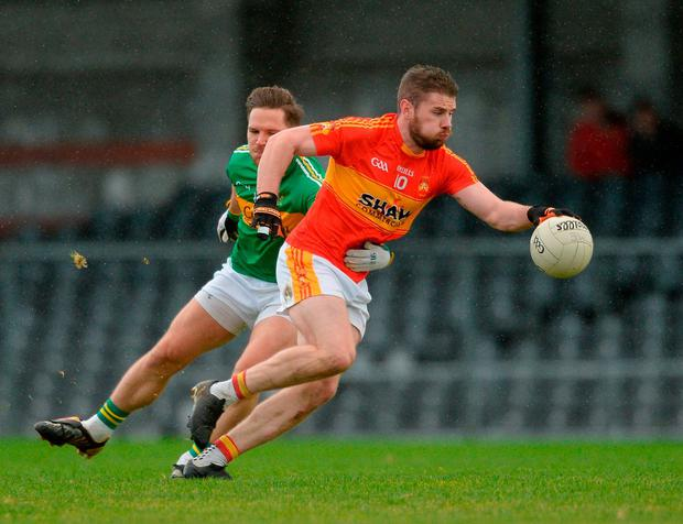 Fergal Durkan of Castlebar Mitchels in action against Brian Egan of Tourlestrane. Photo: Piaras Ó Mídheach/Sportsfile