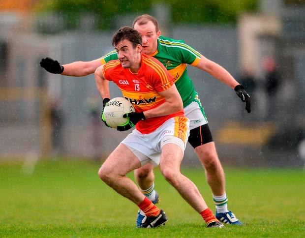 Fergal Durkan of Castlebar Mitchels in action against Barry Walsh of Tourlestrane. Photo: Piaras Ó Mídheach/Sportsfile