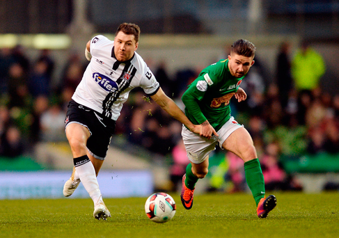 Dundalk's Brian Gartland in action against Cork City's Seán Maguire. Photo: Eóin Noonan/Sportsfile