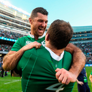 Rob Kearney celebrates with team-mate Donnacha Ryan after beating the All Blacks