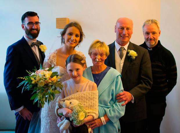 Sean Nolan with bride Lynne Cahill, daughter Ava, Lynne's mother and father Catherine and Larry Cahill, and priest Fr Paddy Banville. Photo;Sean Nolan