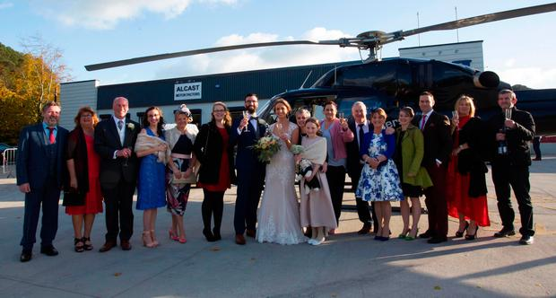 The wedding party and the helicopter. Photo;Mary Browne