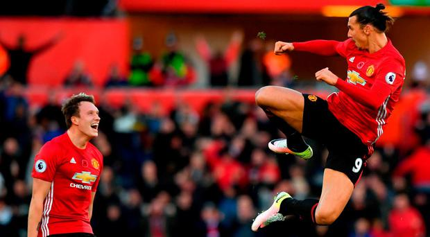 Zlatan Ibrahimovic celebrates his second goal alongside Phil Jones as he gives Manchester United a kick start against Swansea. Photo: Stu Forster/Getty Images