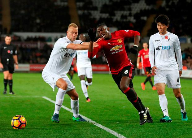 Manchester United's Paul Pogba (centre) in action against Swansea City's Mike van der Hoorn (left) and Ki Sung-yueng. Photo: Nick Potts/PA Wire.