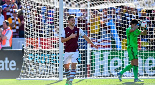 Colorado Rapids' Kevin Doyle (9) celebrates his penalty