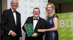 Alan Dukes, Public Affairs Consultant and former Government Minister whoChaired the judging panel is pictured with Oonagh O'Mahony (IFP Media), Chair, Guild of Agricultural Journalists, presenting the Category Award for Best Print Feature Article for 'Cowtown Revisited', to Declan O'Brien, Farming Independent. Photo; Johnny Bambury