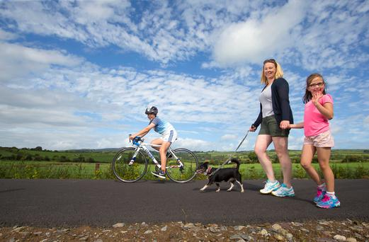 Celebrating the opening to the public of the Kilmacthomasto Dungarvan section of the Waterford Greenway is Jacqui de Paor with her daughter Grainne and son Seán.