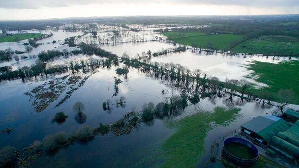 Flooding as far as the eye can see in Clonlara, Co Clare last January. The EPA has warned that extreme events such as last winter's flooding are likely to increase in frequency and intensity. Photo: Brian Gavin Press 22